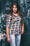 Sexy beautiful woman in check shirt. In studio Royalty Free Stock Photos