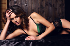 Sexy beautiful woman with dark hair in elegant lace lingerie Stock Photo