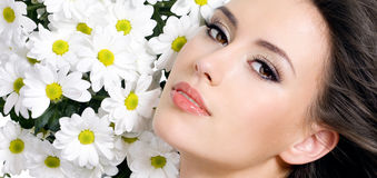 beautiful woman face with flowers Stock Photo
