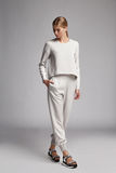 Sexy beautiful woman fashion model wear white silk casual suit Stock Images