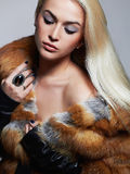 Sexy beautiful Woman in Fur Coat. winter Beauty Fashion Model Girl Royalty Free Stock Images