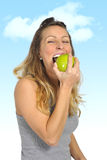 Sexy beautiful woman holding green apple fruit in healthy natural nutrition and fitness concept Stock Photography