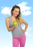 Sexy beautiful woman holding green apple fruit in healthy natural nutrition and fitness concept Royalty Free Stock Image