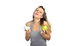 Sexy beautiful woman holding green apple fruit in healthy natural nutrition and fitness concept Stock Photos