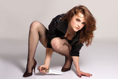 Sexy beautiful woman with knife Royalty Free Stock Image