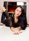 Sexy woman in front of a blazing fire Royalty Free Stock Image