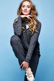 beautiful woman long blond curly hair wear merino wool suit Stock Images