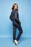 beautiful woman long blond curly hair wear merino wool suit Stock Photography