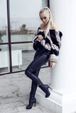 Sexy beautiful woman with long straight hair wearing luxurious fur coat. Fashion outdoor photo of sexy beautiful woman with long straight hair wearing luxurious Royalty Free Stock Image