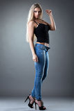 Sexy Beautiful woman posing in jeans Royalty Free Stock Photo