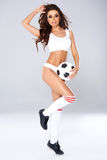 Sexy beautiful woman posing with a soccer ball Royalty Free Stock Photo