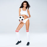 Sexy beautiful woman posing with a soccer ball Stock Image