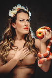 Sexy beautiful woman with red apple and snake Stock Image