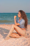 Sexy beautiful woman sitting at the beach Royalty Free Stock Photo