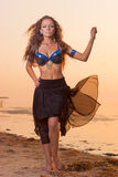 Sexy beautiful woman in the skirt on the beach Royalty Free Stock Photography