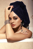 Sexy beautiful woman with towel on her head,posing in bathroom Royalty Free Stock Image