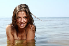 and beautiful woman in the water Stock Image