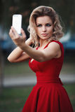 Sexy beautiful young blonde model a red dress Stock Images