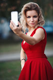 Sexy beautiful young blonde model a red dress Royalty Free Stock Photography