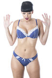 Sexy Beautiful Young Shocked Woman Wearing Navy Blue and White Lacy Lingerie Royalty Free Stock Photography