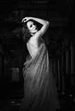 Sexy beautiful young woman covered in veil. Black and white Stock Image