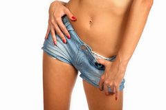 Sexy beautiful young woman wearing denim shorts. Stock Photo