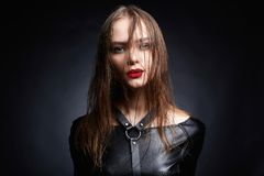 Beautiful young woman with wet hair, wear leather Royalty Free Stock Images