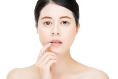 Sexy beauty asian woman touch her lips face camera. Isolated on white background Stock Image