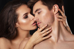 Sexy beauty couple.Kissing couple portrait.Sensual brunette woman in underwear with young lover, passionate couple Stock Photos