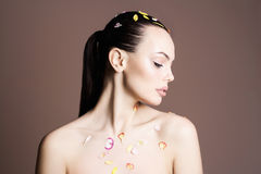 Sexy Beauty girl with flower petals Stock Photography