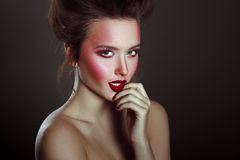 Sexy Beauty Girl with Red Lips and Nails. Provocative Make up Royalty Free Stock Photography