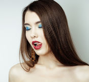 Sexy Beauty Girl with Red Lips and Nails. Provocative Make up. Luxury Woman with Blue Eyes. Fashion Brunette Portrait Royalty Free Stock Photo