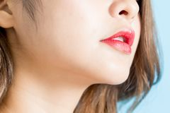 Beauty lips. Closeup of beauty lips isolated on blue background stock photography