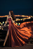 Sexy beauty woman in fluttering red dress Royalty Free Stock Photography