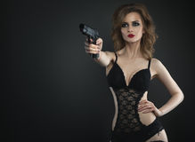 Sexy beauty young woman with gun in lingerie close up portrait Royalty Free Stock Photography