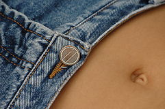 Sexy belly and jeans. A belly of a girl wearing a jeans Royalty Free Stock Photos