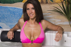 big breasted brunette woman in the jacuzzi Stock Images