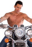 Biker. Male model with no shirt on sitting on a motorcycle. White background stock photos