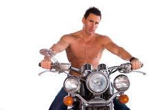 Sexy biker man. Sexy male model with no shirt on sitting on a motorcycle. White background Royalty Free Stock Image