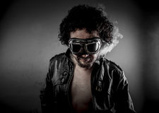 biker with sunglasses era dressed Leather jacket, huge smok Royalty Free Stock Photo