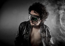 Sexy biker with sunglasses era dressed Leather jacket, huge smok Stock Photo