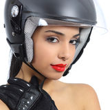 Sexy biker woman with an helmet and gloves. Isolated on a white background Royalty Free Stock Photography