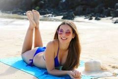 Free Sexy Bikini Girl Lying Down Suntan On Towel Beach Looking To The Side. Summer Holidays Relaxed Fashion Beauty Woman Sunbathing On Stock Photography - 172650232