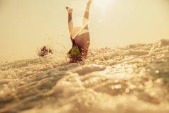 bikini girl swim sea waves splash vintage tone Royalty Free Stock Photos