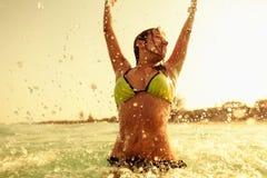 bikini girl swim sea waves splash vintage tone Royalty Free Stock Images