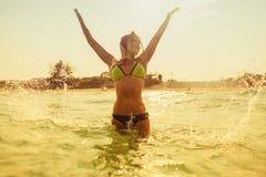 bikini girl swim sea waves splash vintage tone Royalty Free Stock Image