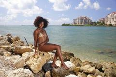 bikini model posing on the rocks south pointe park Royalty Free Stock Photography