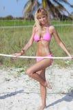 Sexy bikini model posing with a rope Royalty Free Stock Photos