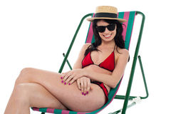 Sexy bikini model relaxing on deckchair Stock Photos