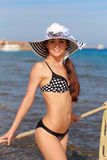 Sexy bikini woman smiling on blue Stock Photos